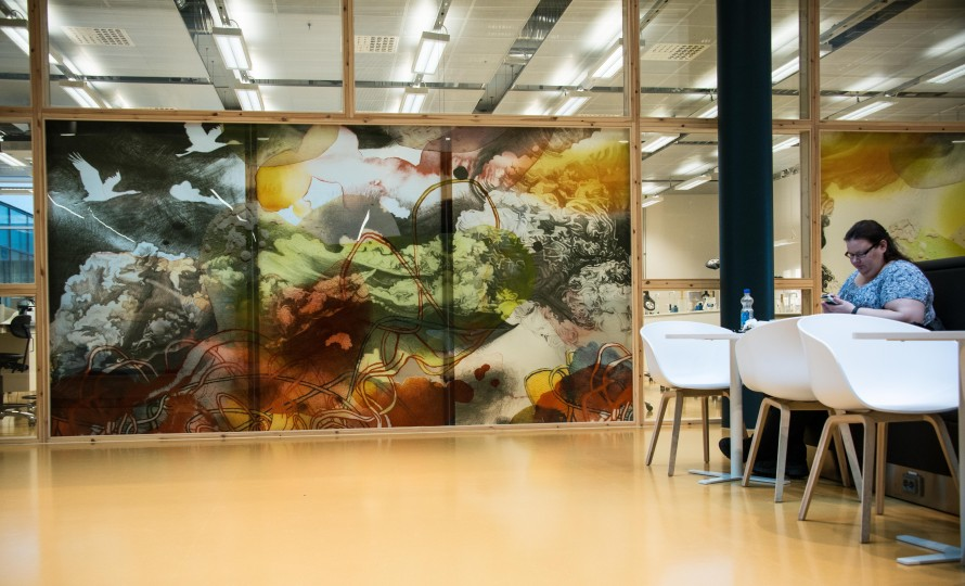 Large painting on a glass wall.