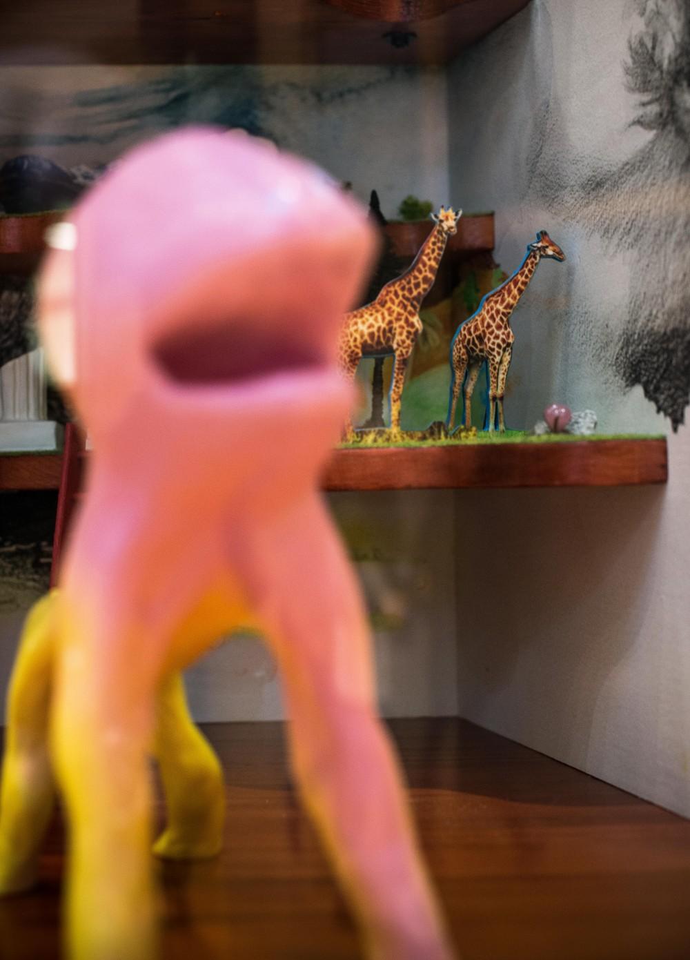 Sculpture of a pink octopus.