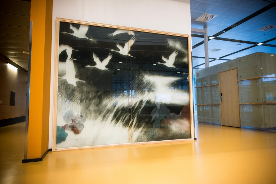 Large painting on glass portraying a group of flying brids.