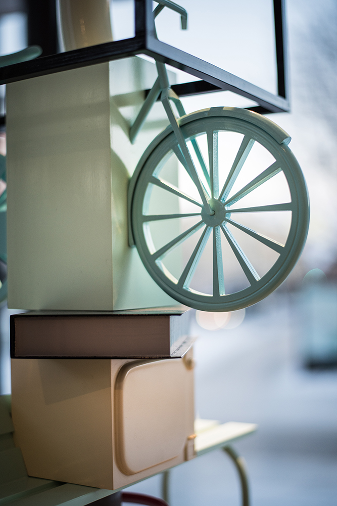 Detail of the pole. Parts of a green bike.