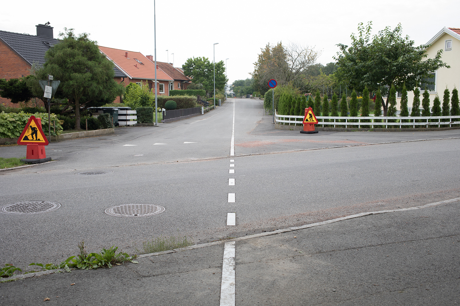 A white line which runs along the street.