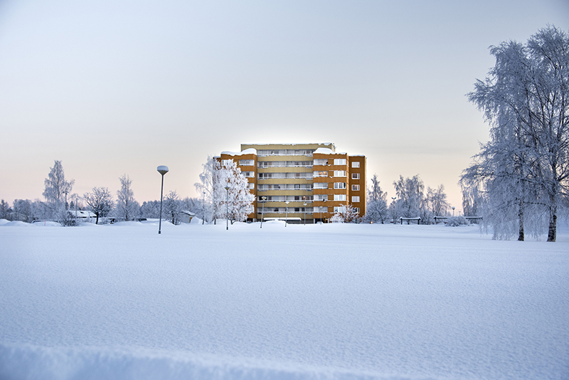 Yellow building in a snowy landscape.