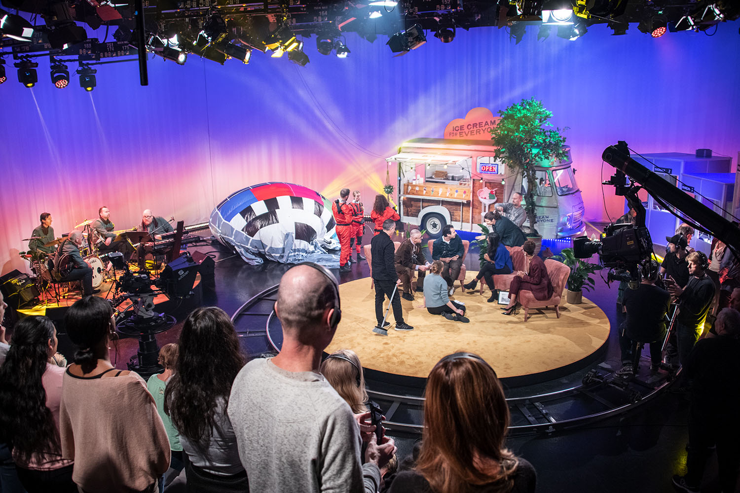 An audience watching a tv-show being recorded.