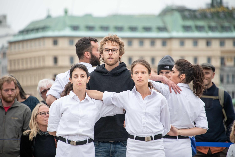 People standing shoulder to shoulder.
