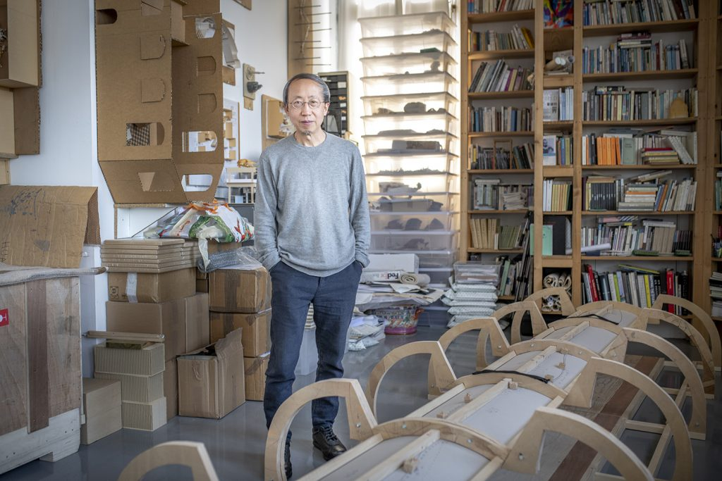 Man standing in a room filled with stuff